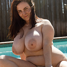 Milly Marks shows her naked body at the side of the pool - Zishy