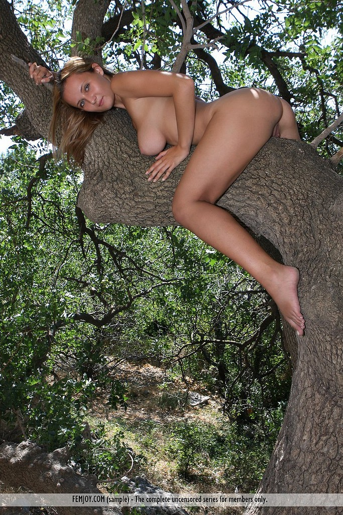 Dark tree naked woman