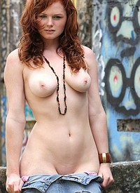 Sexy redhead Elena Marie likes graffiti and being nude ...
